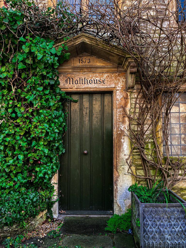 Quaint door of one of the houses in Castle Combe in the Cotswolds